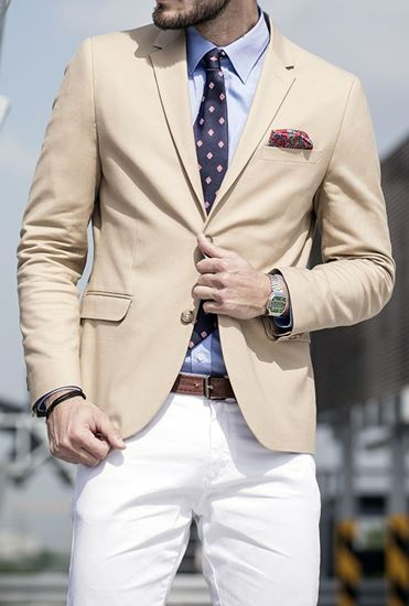 Picture of Beige jacket with white trousers