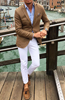 Picture of Camel brown jacket and white trousers