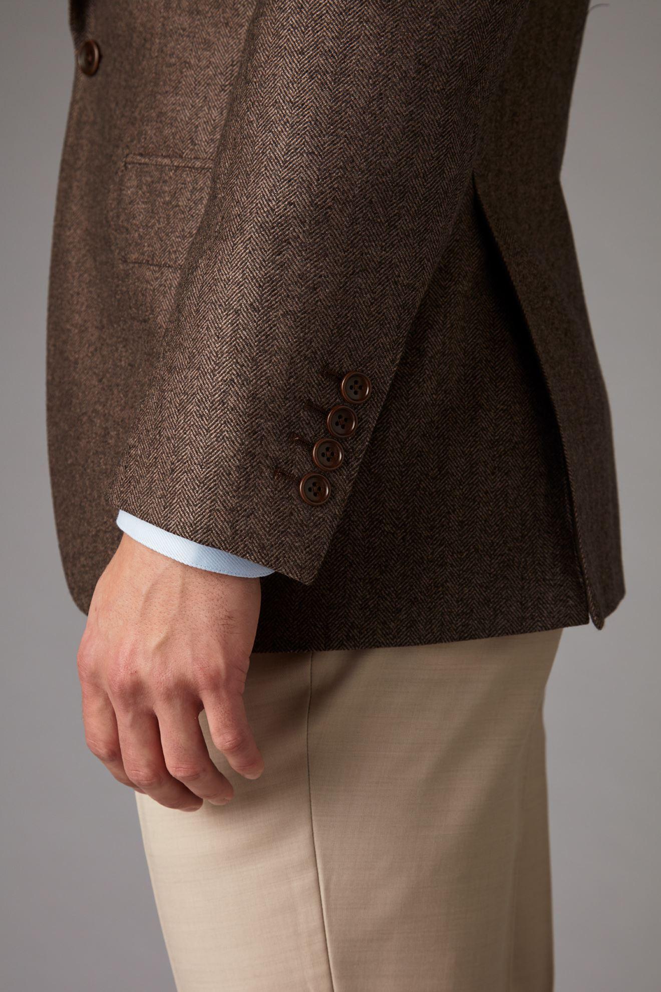 Brown tweed jacket detail